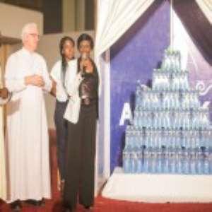 Rev. Father Campbell and Nana Konadu Agyemang Rawlings unveiling Awake