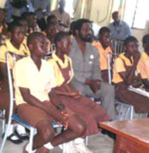 The Mayor (middle) some pupils of the Osu Home JHS interacting with the Bounzel School in New York through the internet