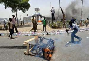 Running battles break out between protesters and soldiers in Nigeria's northern city of Kano in 2011.  By Seyllou Diallo (AFP/File)