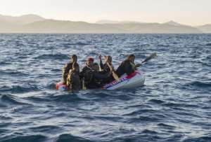Would-be immigrants in an inflatable boat off the Spanish coast on December 3, 2012.  By Marcos Moreno (AFP/File)
