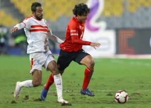 Kodjo Fo-Doh Laba (L) of Renaissance Berkane holds off Hamza Mathlouthi of CS Sfaxien during the first leg of a CAF Confederation Cup semi-final. Sfaxien won 2-0 at home with Mathlouthi scoring the second goal..  By STR (AFP)