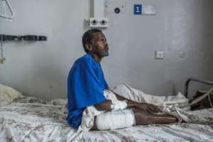 Tamrat Kidanu said he lay motionless after being shot as he heard Eritrean troops massacring his son and other men in Dengolat.  By EDUARDO SOTERAS (AFP)