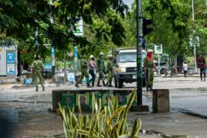 Tanzanian Security Forces arrest two people in Stone Town, Zanzibar.  By Patrick Meinhardt (AFP)