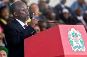 Tanzanian President John Magufuli, seen here at his swearing-in ceremony in November 2015, has cracked down on media critics.  By Daniel Hayduk (AFP)