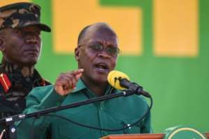 Tanzania's incumbent President and presidential candidate John Magufuli (R) speaks during the August 29 launch of his party's campaign for the October general election.  By ERICKY BONIPHACE (AFP)