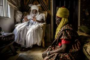 Taking counsel: Clad in his traditional turban, the Sarkin Fulani discusses issues with his assistant. Stigma is one of the biggest problems facing Fulani today, the king says.  By Luis TATO (AFP)