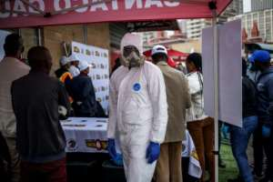 Taxi ranks have deployed cleaners in full protective gear to help with the sanitisation.  By Michele Spatari (AFP)
