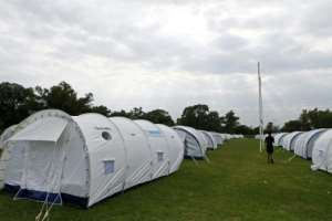 Tent city: Homeless people are being temporarily housed under canvas at the Pretoria West Rugby Stadium.  By Phill Magakoe (AFP)