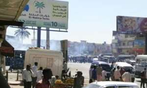 Tear gas hangs over the streets of Khartoum's twin city of Omdurman on January 9, 2019 as Sudanese police disperse an anti-government protest.  By - (AFP)