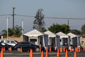 Testing including at drive-in sites has revealed a million new cases in less than a week in the US.  By Apu GOMES (AFP)