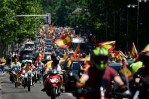 Thousands gathered in Madrid on Saturday to demand an end to the virus restrictions and call on PM Sanchez to quit, in a protest led by the far-right party Vox.  By JAVIER SORIANO (AFP)