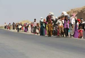 Thousands of Iraqis from the Yazidi community were forced to flee in 2014 when the Islamic State group stormed across swathes of Iraq and Syria.  By AHMAD AL-RUBAYE (AFP/File)