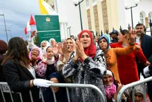 Thousands of Moroccans greeted Pope Francis in the capital Rabat. By Alberto PIZZOLI (AFP)