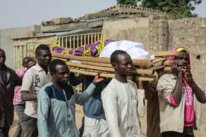 Thousands of people have died since Boko Haram launched its insurgency in 2009. On Tuesday, villagers at Sajeri, near the northeastern Nigerian city of Maiduguri, laid to rest one of three people killed in a jihadist attack.  By Audu MARTE (AFP)