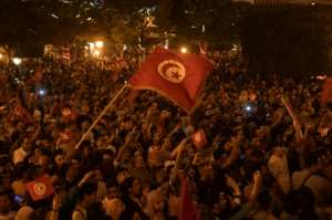 Thousands of people took to the streets of the capital Tunis to celebrate Saied's victory, honking horns and singing the national anthem.  By Fethi Belaid (AFP)