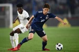 Thomas Partey (L) playing for Ghana against Japan in a friendly international match.  By Martin BUREAU (AFP/File)