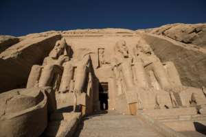 The colossal statues of a seated Ramses II at the entrance of Abu Simbel archaeological site, rescued from the waters of the reservoir behind the Aswan Dam.  By Khaled DESOUKI (AFP)