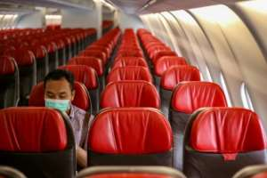 The coronavirus has seen airlines stop flights to China and countries close its borders to travellers from China.  By ADAM TANJUNG (AFP)