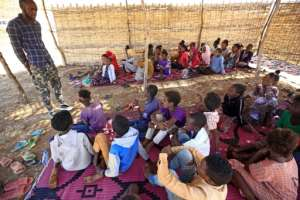 The camp's teachers say they want their makeshift classrooms to provide a place where refugee children can feel safe after the horrors some of them saw back home in Ethiopia.  By ASHRAF SHAZLY (AFP)