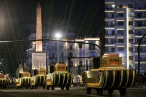 The carriages carrying 22 ancient Egyptian royal mummies advance past the Obelisk of Ramses II along Tahrir Square as they depart from the Egyptian Museum to their new home.  By Mahmoud KHALED (AFP)