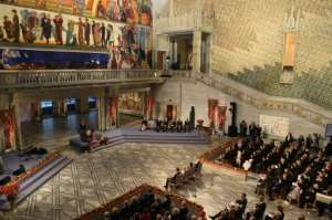 The ceremony took place at the Oslo city hall, with Abiy denouncing the