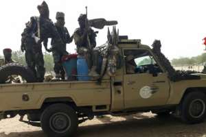 The Chad troops riding pick-up trucks and tank transporters, crossed the bridge back home to N'djamena via the Cameroon border town of Kousseri under the curious gaze of locals.  By - (AFP)