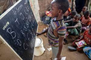 The children are taught reading, writing and maths.  By Mohamed ABDIWAHAB (AFP/File)