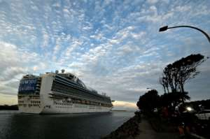 The cruise ship Ruby Princess departs from Port Kembla in Australia after a few hundred virus-free crew members disembarked.  By Saeed KHAN (AFP)