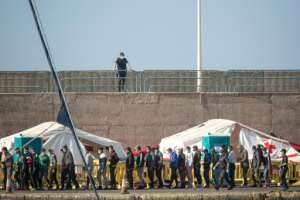 The Arguineguin port camp was put up to process arrivals and run virus tests but it has become saturated with more than 2,000 migrants sleeping there.  By DESIREE MARTIN (AFP)