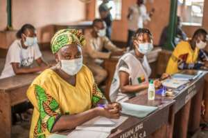 The autonomous national election commission (CENA) made face masks mandatory for voting and enforced social distancing measures at polling stations.  By Yanick Folly (AFP)