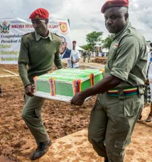 The biggest cake each year was said to weigh the same number of kilogrammes as Mugabe's age. It took several men to carry it into the marquee