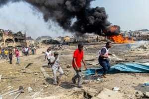 The blast destroyed around 50 buildings in a residential area.  By Benson IBEABUCHI (AFP)