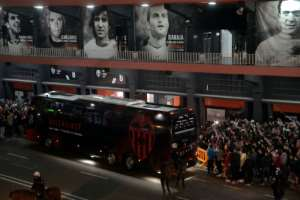 The bus transporting Valencia's players arrives at the Mestalla Stadium in Valencia before football match between Valencia and Atalanta that will be played behind closed doors in light of the virus outbreak.  By JOSE JORDAN (AFP)