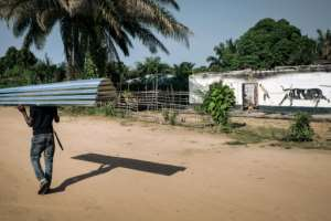 The government has offered residents building materials for the reconstruction of houses in Yumbi. By ALEXIS HUGUET (AFP)