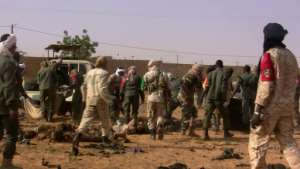 The dead and injured are evacuated following a suicide bomb attack that ripped through a camp grouping former rebels and pro-government militia in Gao, in the troubled northern Mali left 50 people dead on January 18, 2017 in Ga
