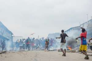 The demonstrators blocked a road with barricades at the Kinshasa Grand market.  By ARSENE MPIANA (AFP)