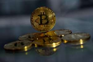 The difficulty of transferring money in sub-Saharan Africa has made cryptocurrencies attractive for Nigerians despite the volatility of bitcoin.  By Justin TALLIS (AFP)