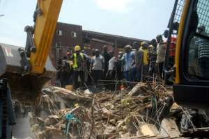 The disaster revived a fierce debate in Nigeria about illegally or poorly-construction buildings. Regulations are routinely flouted. By SEGUN OGUNFEYITIMI (AFP)