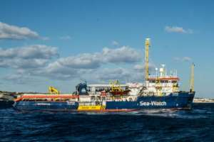 The Dutch-flagged Sea Watch 3 docked in Lampedusa despite efforts of a coastguard boat to prevent her from doing so.  By FEDERICO SCOPPA (AFP/File)