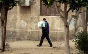 The Egyptian Food Bank is committed to shipping out an initial lot of 500,000 food cartons throughout the country's 27 governorates with around 5,000 charities distributing the parcels.  By Mohamed el-Shahed (AFP)