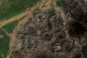 The ethnic conflict has destroyed villages in a spiral of violence, like the Fulani village of Sadia-Peulh, seen here from the air.  By Marco LONGARI (AFP)