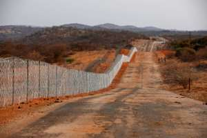 The fence separating South Africa and Zimbabwe has been notoriously porous since its de-electrification in 1994.  By Phill Magakoe (AFP)