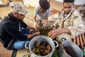 The fighters prepare a feast of stuffed pigeons and grilled meat, to give them strength for what they expect to be a renewed upsurge in combat.  By Mahmud TURKIA (AFP)