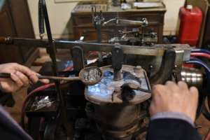 The French-made typecasting machine is over a century old.  By Ahmad HASSAN (AFP)