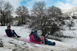 The kids might be enjoying the snow, but their parents say some are of an age when they should be at school.  By Sakis MITROLIDIS (AFP)