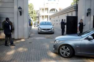 The Hawks police investigative unit and the tax service descended on the Guptas' heavily protected compound in the upmarket Johannesburg suburb of Saxonwold.  By WIKUS DE WET (AFP/File)