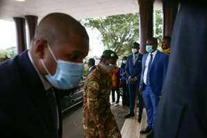 The head of the Malian military junta, Col. Assimi Goita, centre, arriving in Ghana for the ECOWAS summit.  By Nipah Dennis (AFP)