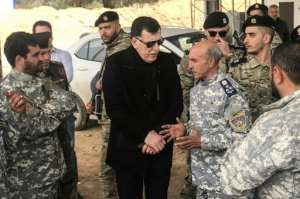 The head of Libya's UN-backed unity government Fayez al-Sarraj meets commanders who helped retake the checkpoint. By Mahmud TURKIA (AFP)