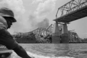 The Onitsha bridge, one of the most important communication pathways of West Africa, is destroyed by the Biafran forces.  By Colin HAYNES (AFP/File)