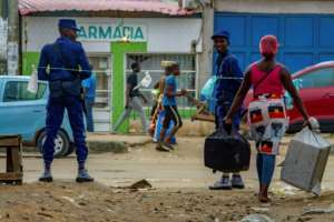 The lockdown order has largely gone unnoticed in the daily grind and hustle on the capital's streets.  By Osvaldo Silva (AFP)